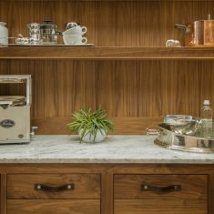 Arbor Mills Walnut Pantry Cabinet with Built In Lighting