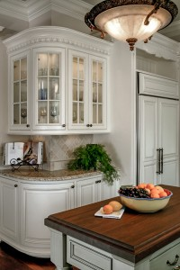 above cabinet decorating space -Adding plants or pictures over your cabinets expands your decor.